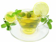 Fruit tea with lemon and mint. Fruit tea with lemon and fresh mint royalty free stock photography