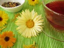 Fruit tea with marigolds Royalty Free Stock Photo