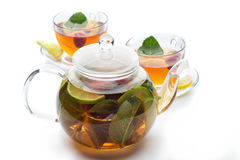 Fruit tea with mint leaves in a teapot Royalty Free Stock Image