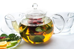 Fruit tea with mint leaves in a teapot Royalty Free Stock Photo