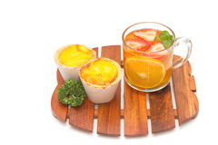 Fruit tea with Parsley and Egg tarts Stock Images