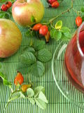 Fruit tea with rose hips and apples Stock Images