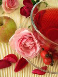 Fruit tea with rose hips, apples and rose flowers Stock Photo