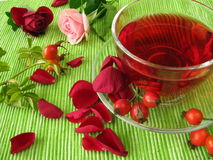 Fruit tea with rose hips and rose flowers Stock Photos