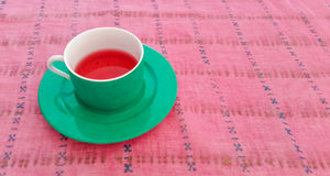 Fruit Tea Served in a Tea Cup Stock Images