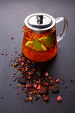 Fruit tea with slice of lemon. Mixture herbal floral fruit tea with petals, dry berries and fruits. Stock Photography