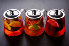 Fruit tea with slice of lemon. Mixture herbal floral fruit tea with petals, dry berries and fruits. Stock Image