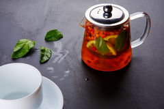 Fruit tea with slice of lemon. Mixture herbal floral fruit tea with petals, dry berries and fruits. Royalty Free Stock Photos