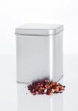 Fruit tea steel jar with loose tea next to it Stock Image