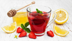 Fruit tea with strawberries and honey Stock Photography