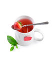 Fruit tea with strawberry as teabag royalty free stock photography