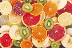 Fruit textures. Kiwi orange grapefruit lemon apple pear pomegranate mandarin fruits as background cover wallpaper. Colorful fresh fruits in rainbow colors stock photos