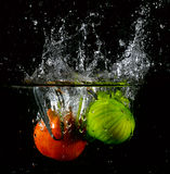 Fruit thrown in water Royalty Free Stock Photo