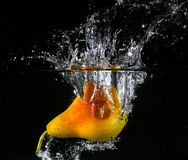Fruit thrown in water Royalty Free Stock Photography