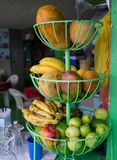 Fruit in 3-tiered wire basket in window of cafe in Mexico stock images