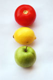 Fruit traffic light. Concept of fruits representing traffic light on white background (perspective with thin depth of field Stock Images