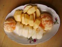 Fruit salad plate. Apple, pear and mandarin orange Royalty Free Stock Photography