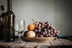 Fruit tray and a bottle Stock Image