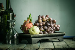 Fruit tray and a glass  with of vintage. Stock Photos