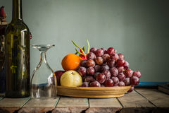Fruit tray and a glass Royalty Free Stock Image