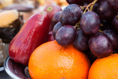 Fruit in tray with orange , grapes and rose apple Royalty Free Stock Photo