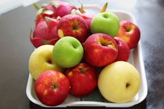 Fruit in a tray on wood table Stock Images