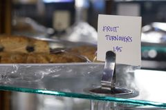 Fruit turnovers. Fruit turnover with sign in bakery display Stock Photography