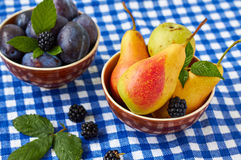 Fruit variety. Fruit variety in a  bowls.Pears, plums and blackberries Royalty Free Stock Images