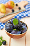 Fruit variety. Fruit variety in a bowls.Pears, plums and blackberries Royalty Free Stock Photos