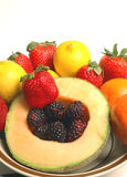 Fruit variety cantaloupe strawberry raspberry Royalty Free Stock Photography