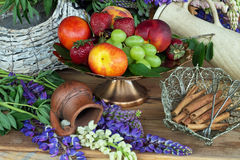 Fruit vase copper with peaches , green grapes and red strawberries Stock Images