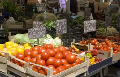 Fruit and veg market. A veg market stall. Tomatoes in foreground Royalty Free Stock Photo