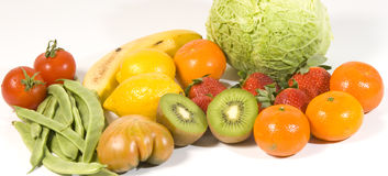 Fruit and vegatables. Variety of fresh fruit and vegetables isolated on white Stock Photography