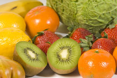 Fruit and vegatables. Variety of fresh fruit and vegetables isolated on white Royalty Free Stock Photography