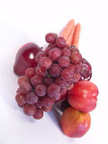 Fruit and Vegetable. A bunch of fruit and vegetable, including, carrot, apple, apricot and grapes stock image