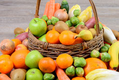 Fruit and vegetable basket Stock Photos