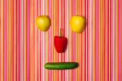 Fruit-vegetable face. top view. humor. T-vegetable face. top view. humor. colorful background royalty free stock photos