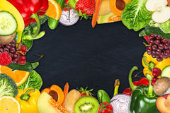 Fruit and vegetable frame. Frame out of fruits and vegetables on slate background Royalty Free Stock Photography