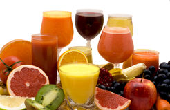 Fruit and vegetable juice. Glasses of fruit and vegetable juice with fruits on a white background Stock Photos