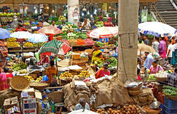 Fruit and Vegetable Market at Panjim, Goa. Panjim, Goa, India - April 27, 2017: Vendors and customers trade at the daily fruits and vegetable market in Panjim royalty free stock image