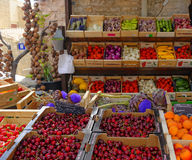Fruit and Vegetable Market in Provence. Outdoor market with boxes of colorful fruit and vegetables in Gordes, Provence, France Royalty Free Stock Image