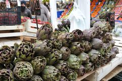 Fruit and vegetable market in Rome. Artichoke booth in the fruit and vegetable market in the historic district of Testaccio in Rome Royalty Free Stock Photos