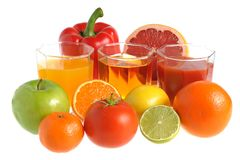 Fruit and vegetable mix with three glasses filled with juice iso Stock Photo