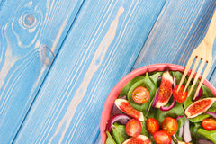 Fruit and vegetable salad with wooden fork, concept of healthy nutrition, copy space for text on boards Royalty Free Stock Photography
