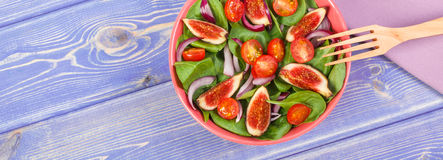 Fruit and vegetable salad with wooden fork, concept of healthy nutrition, copy space for text on boards Royalty Free Stock Image