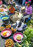 A fruit and vegetable seller with her children at the Indian market in Otavolo in Ecuador. Royalty Free Stock Photos