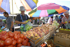Fruit and vegetable sellers at the market. Picture of a Fruit and vegetable sellers at the market.August 1,2015. Resen, Macedonia stock images