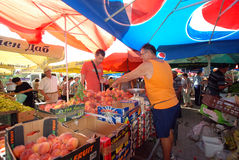 Fruit and vegetable sellers at the market Stock Photo