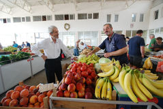 Fruit and vegetable sellers at the market Stock Photos
