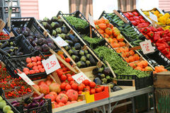 Fruit and vegetable stand with basket full of seasonal fruits in Royalty Free Stock Photo